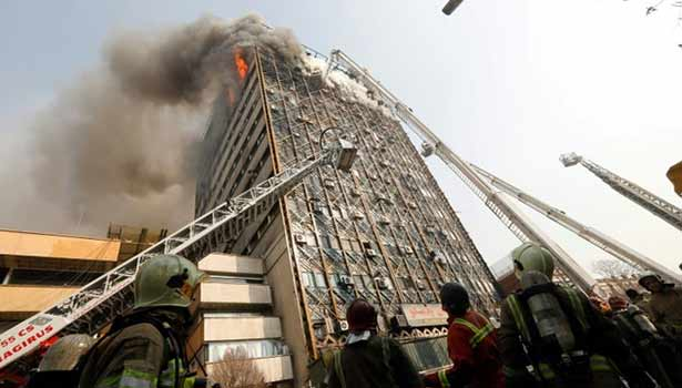 201701191801271563_Iran-firefighters-feared-trapped-in-building-collapse_SECVPF